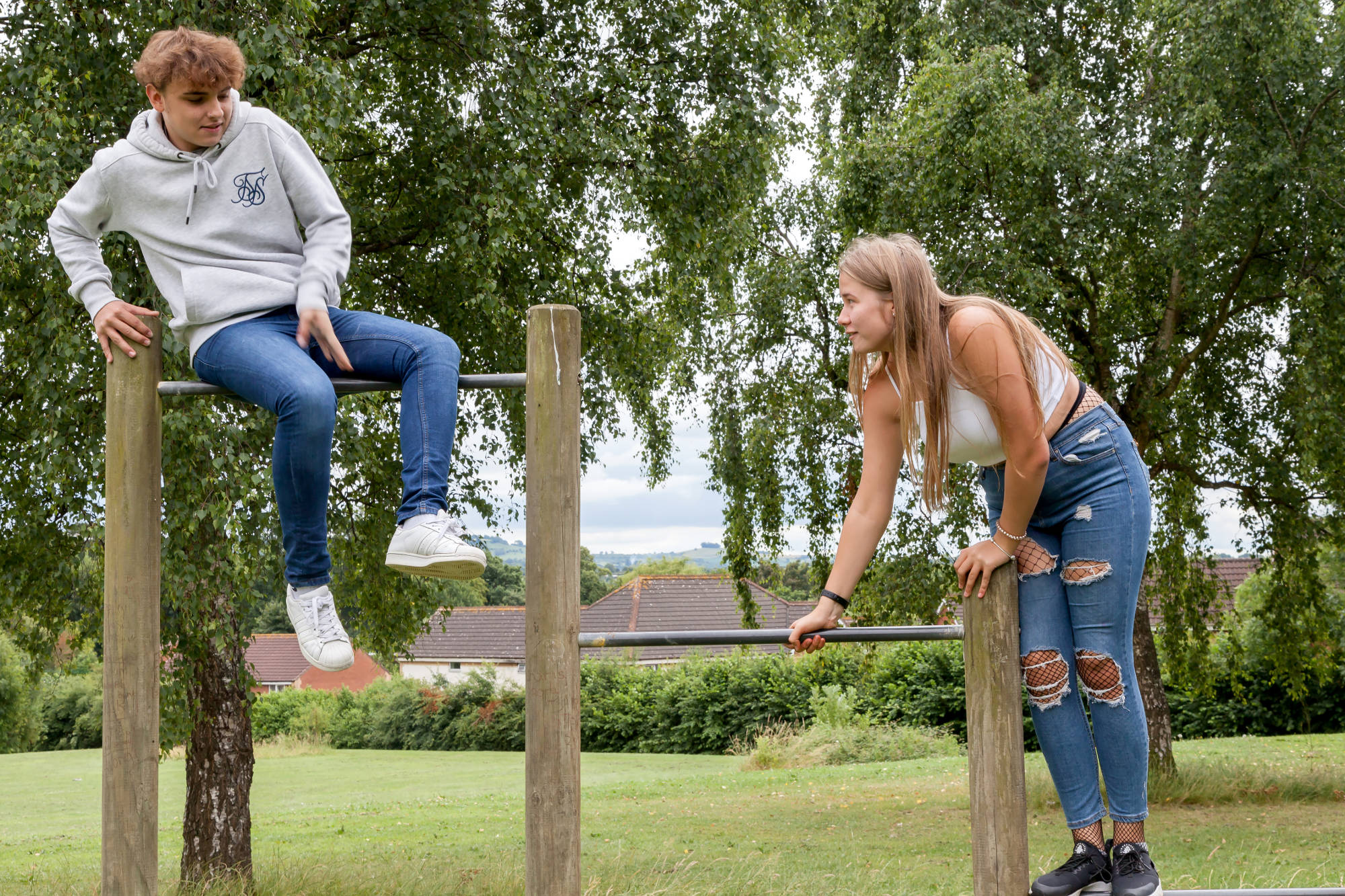 Two young people on a climbing frame