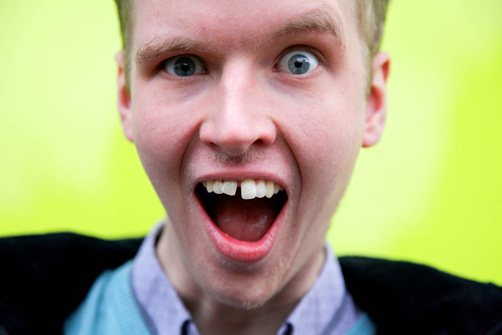 Young person with mouth wide open