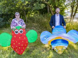 Chair of Council, Councillor Ruth Davis and Leader of the Council, Toby Savage holding two of the bee trail bees.