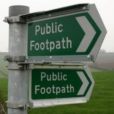 A public footpath sign in a park