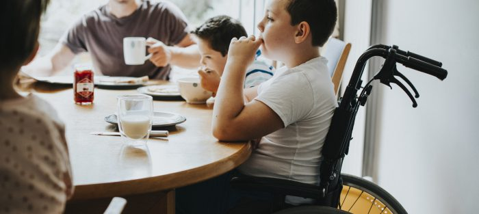 Family having breakfast at the kitchen table
