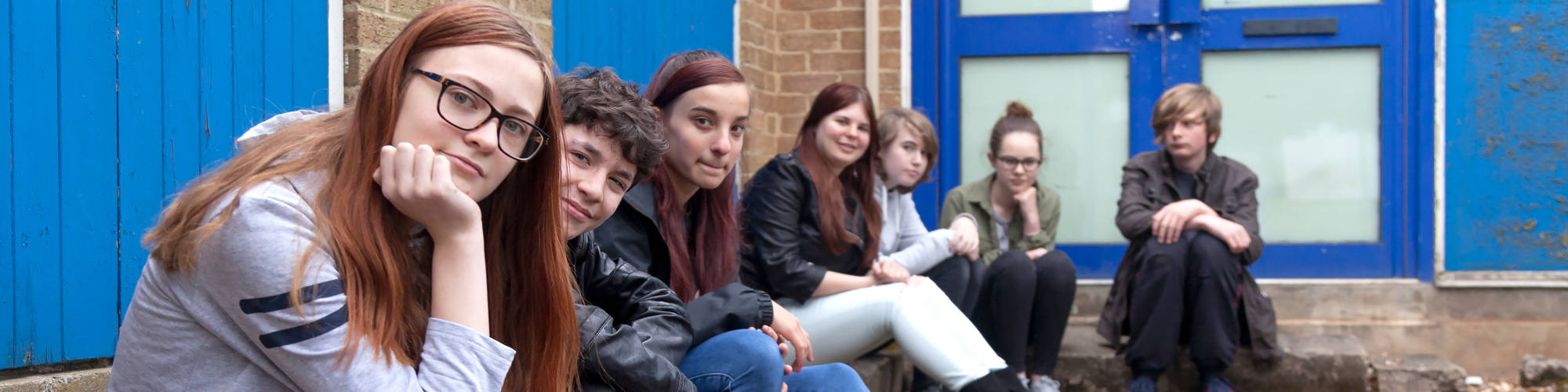 A row of seated teens