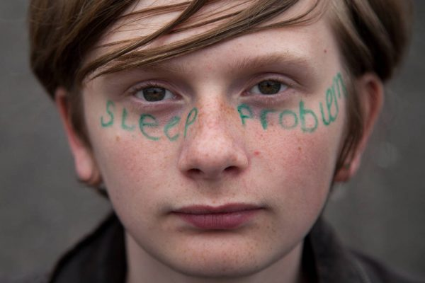 Young person with sleep problem written across his face