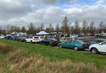 Vehicles queuing for community surge testing for Covid-19 variant in Emersons Green