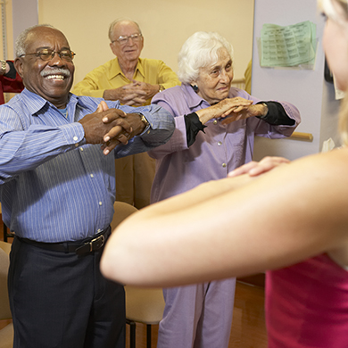 Senior adults in an exercise class watching instructor