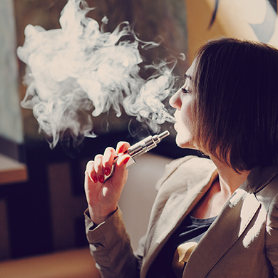 A woman using a vapouriser